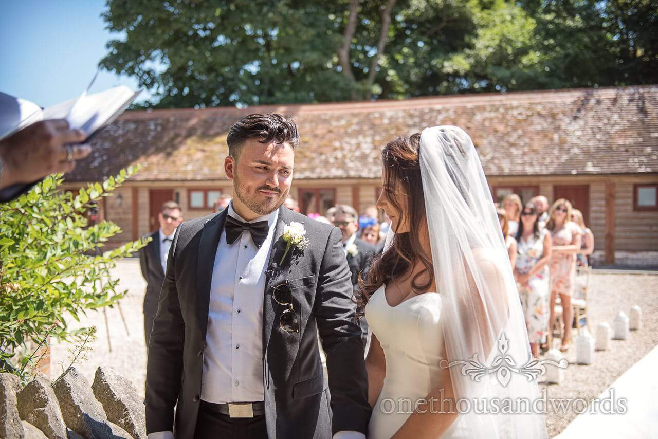 Bride and groom share a look at Country Courtyard Wedding