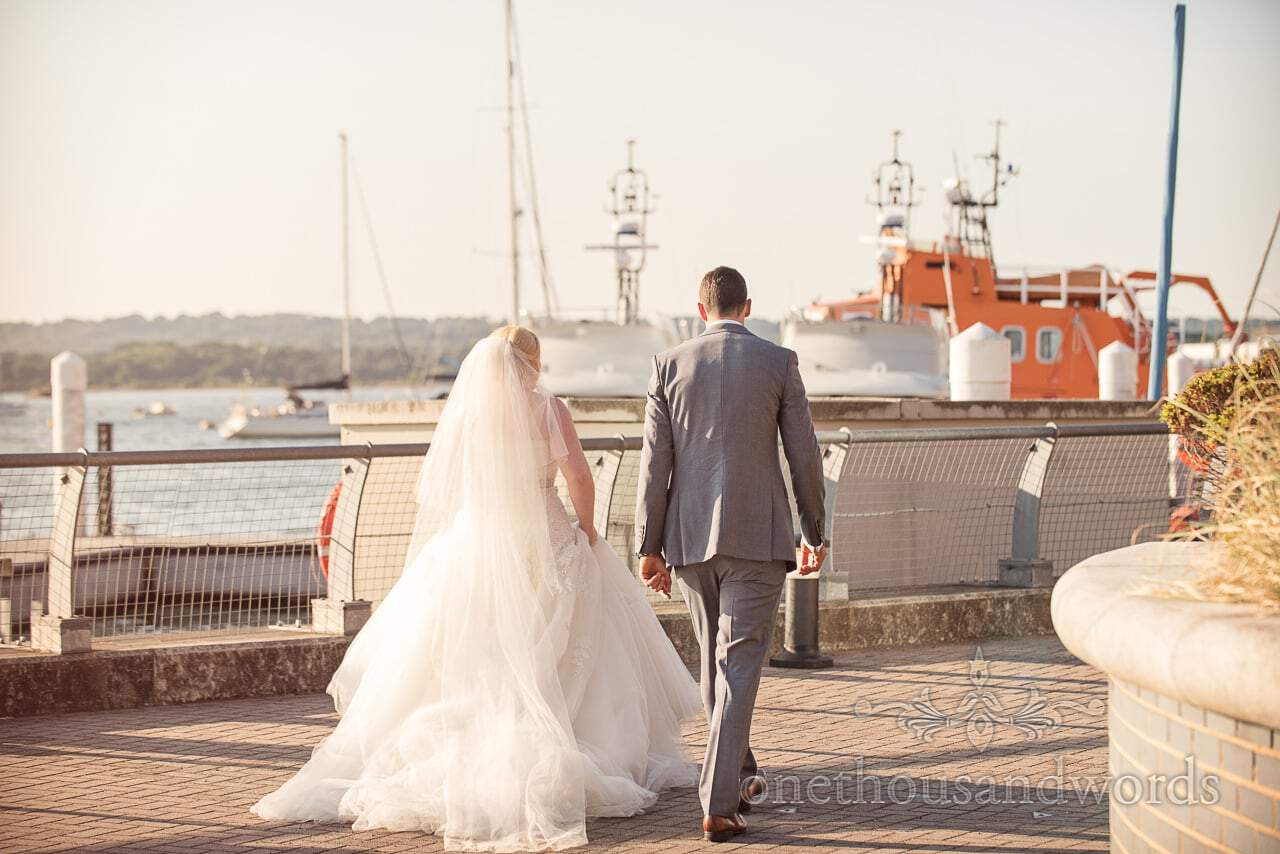 Bride and groom take a walk around the RNLI College at Wedding