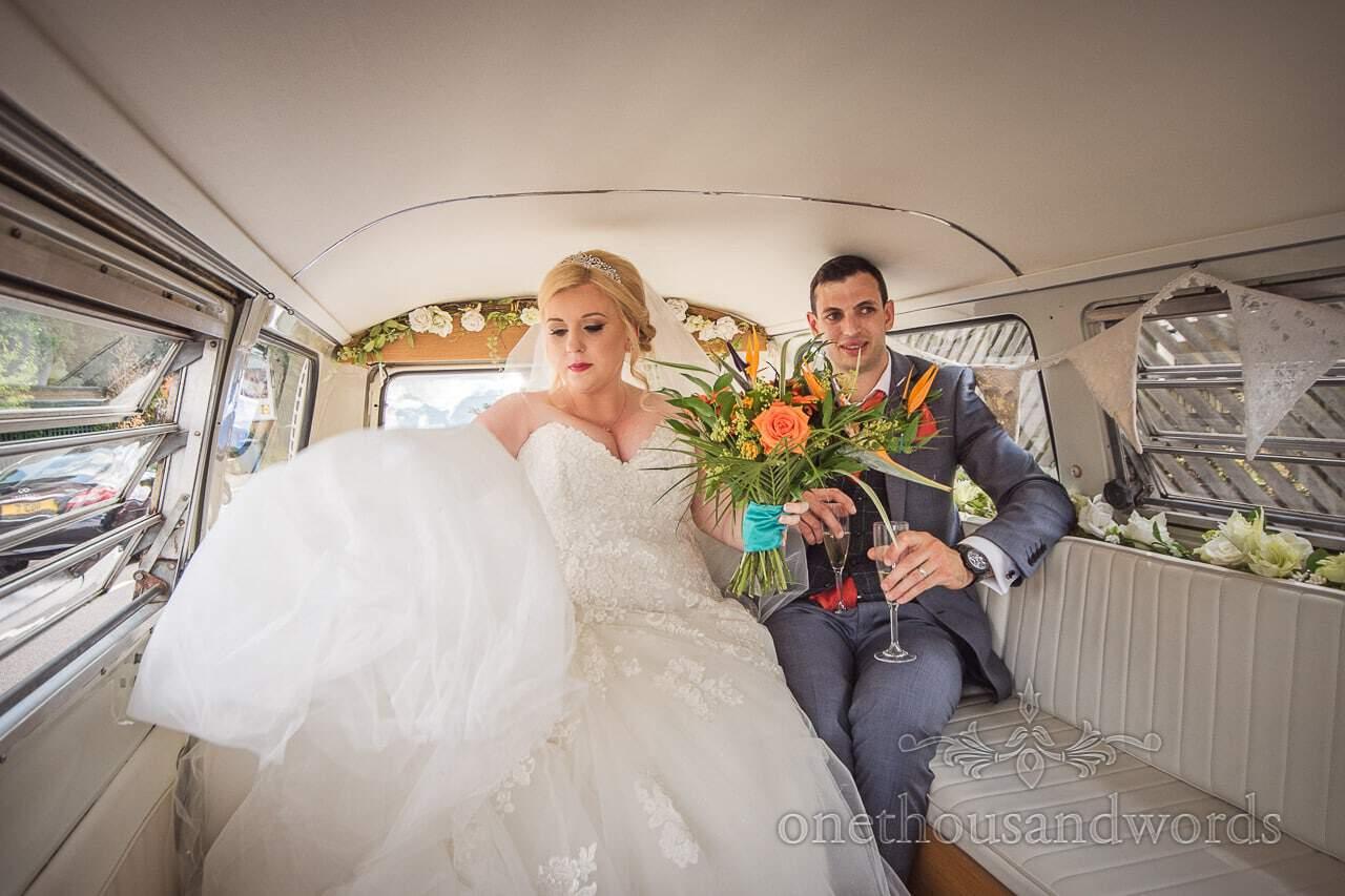 Bride and groom travel in VW camper van to RNLI college wedding venue in Dorset