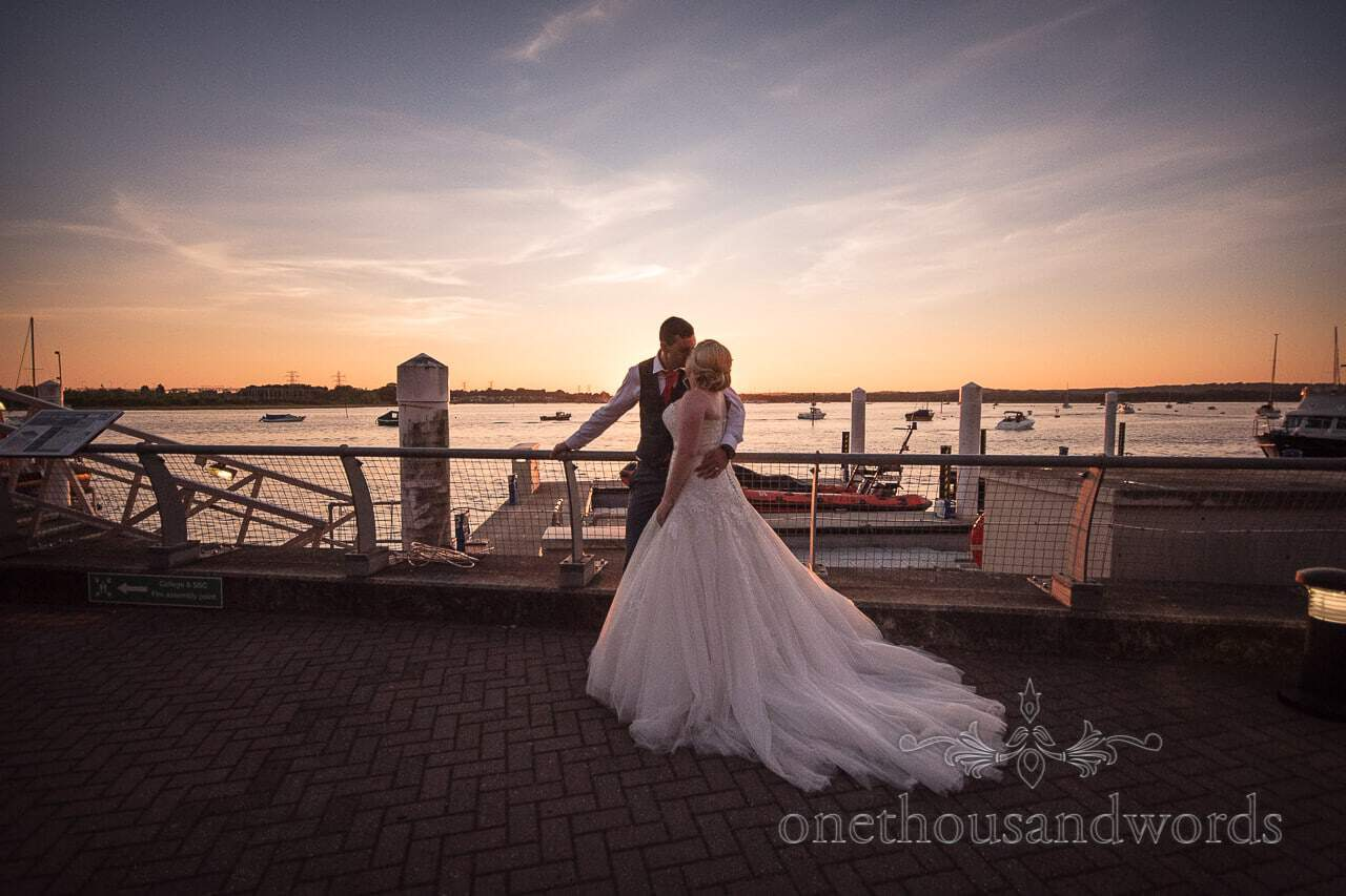 Bride and groom wedding photographs at RNLI College Poole sunset
