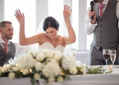 Bride give father a whoop whoop during wedding speeches at Sandbanks Hotel