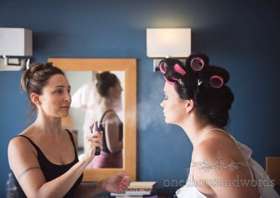 Bride has make up fixing spray added by Peachy Glam at Sandbanks Wedding
