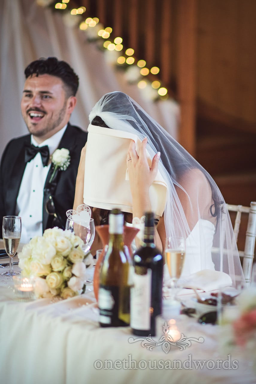 Bride hides her face during speeches at Country Courtyard Wedding