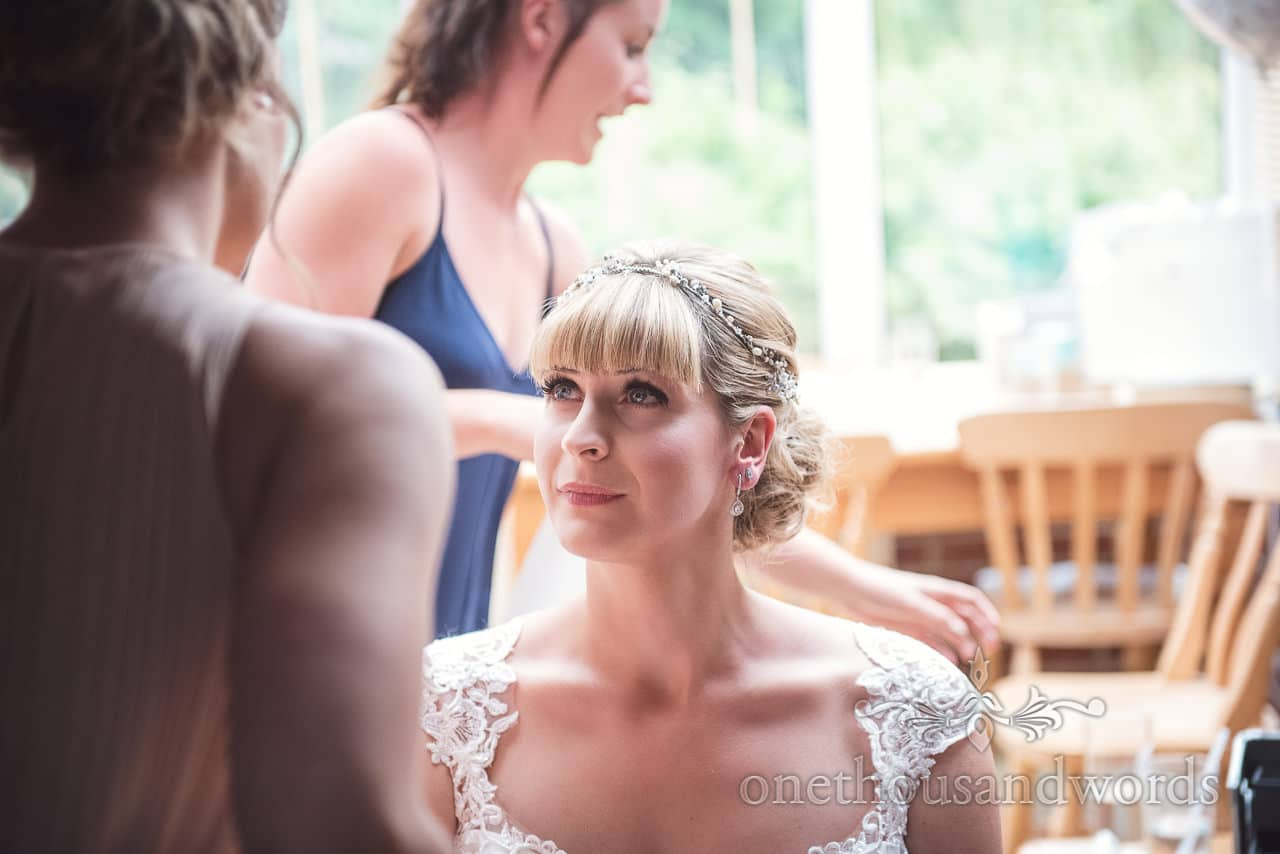 Bride tears up during bridal preparations on wedding morning