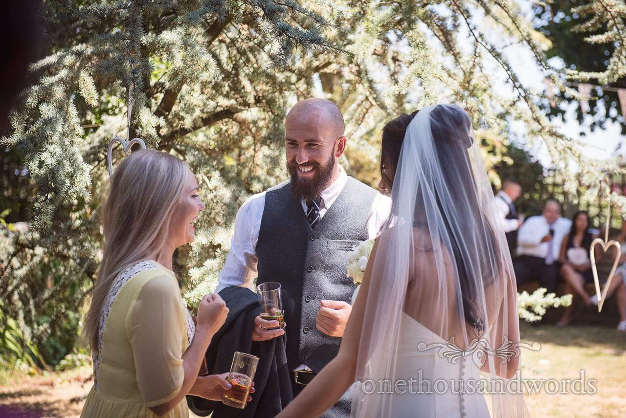 Bride with guests at garden drinks reception at Courtyard Wedding