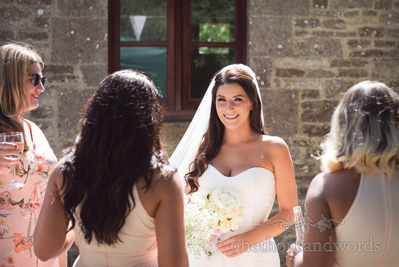 Bride with guests in the sunshine at Country Courtyard Wedding