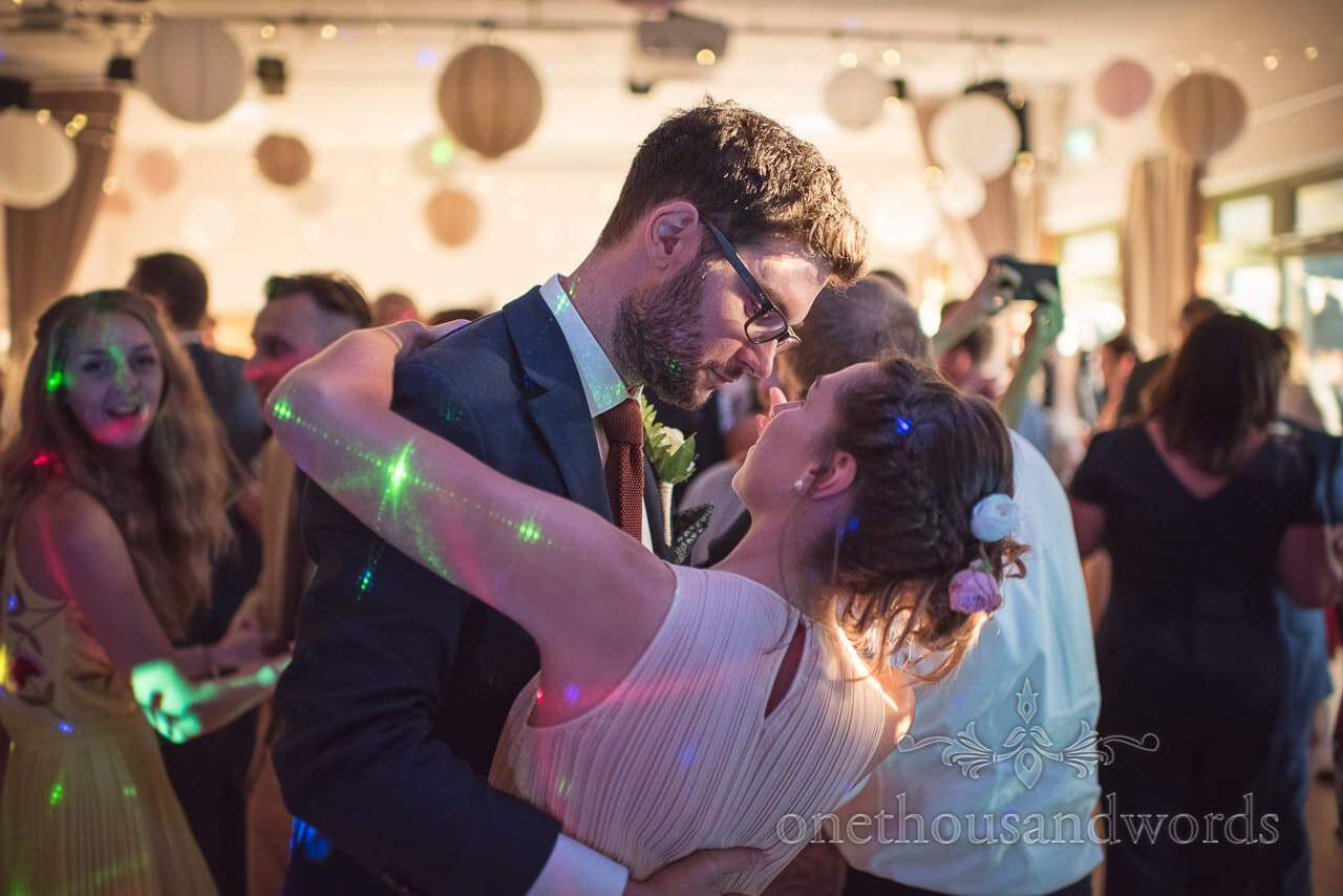 Bridesmaid and partner dance at Harmans Cross Village Hall Wedding evening