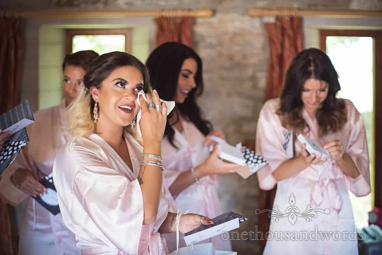 Bridesmaid cries upon receiving gift and card from bride on wedding morning