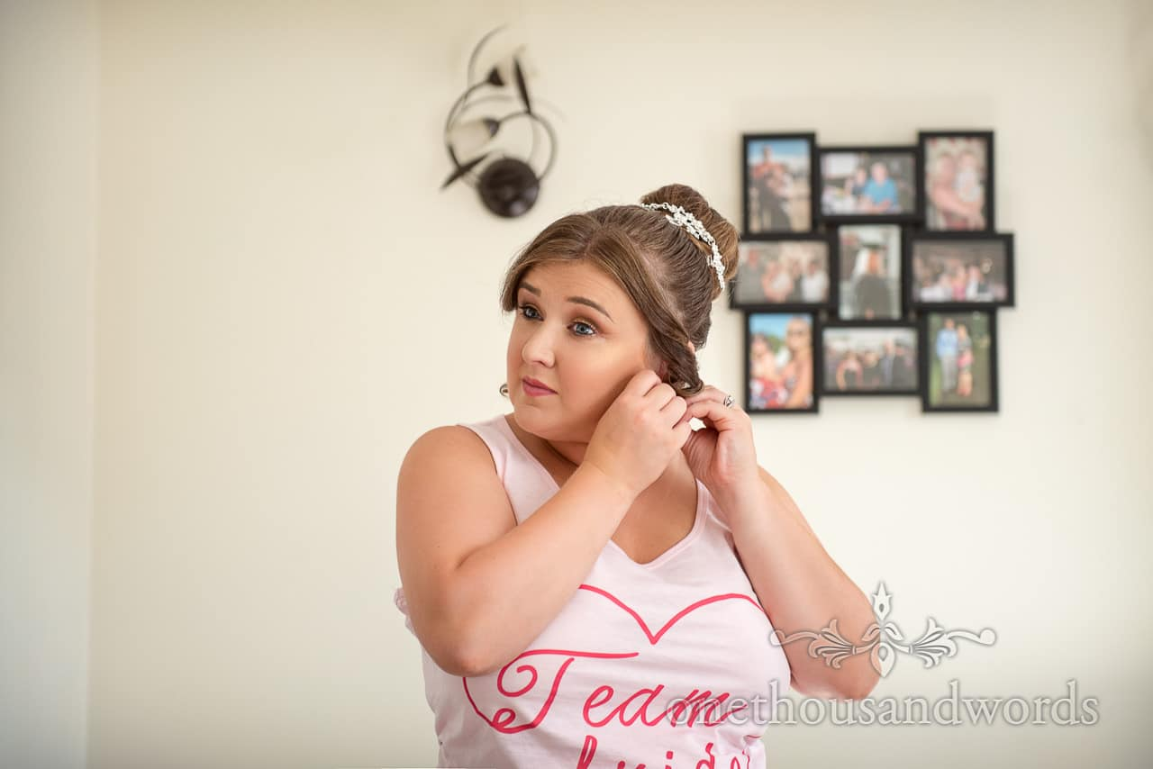Bridesmaid puts on ear rings on morning of RNLI College Wedding Photographs