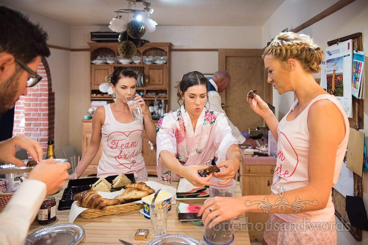 Bridesmaids enjoy chocolate brownies food during bridal preparations