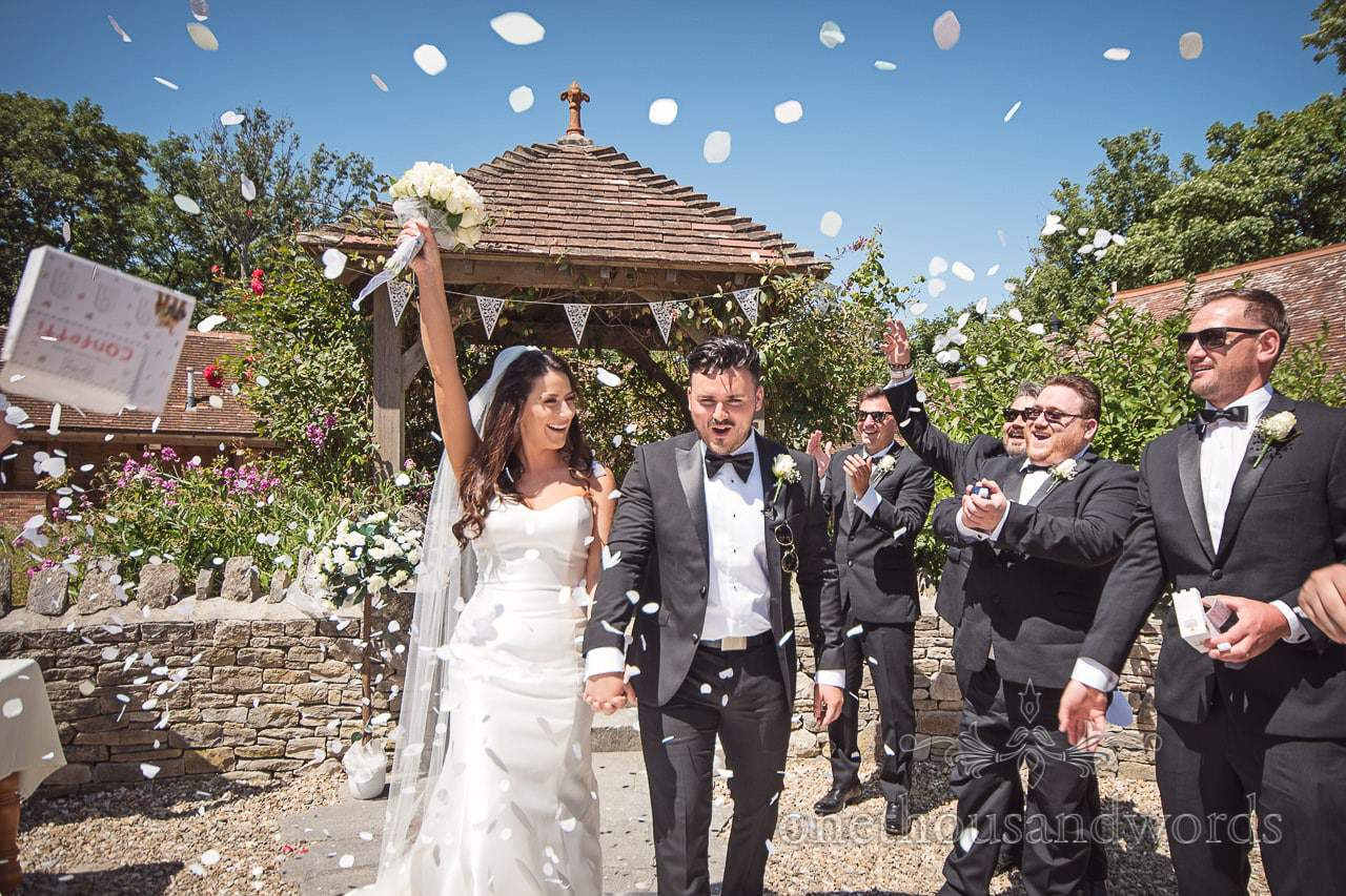 Confetti and box thrown at newlyweds at Country Courtyard Wedding