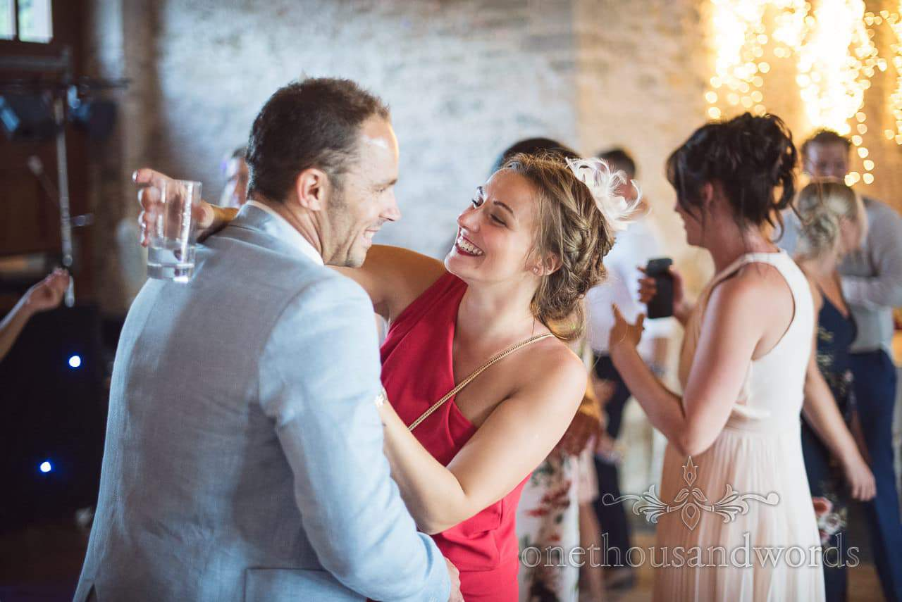 Dancing couple during barn reception at Country Courtyard Wedding