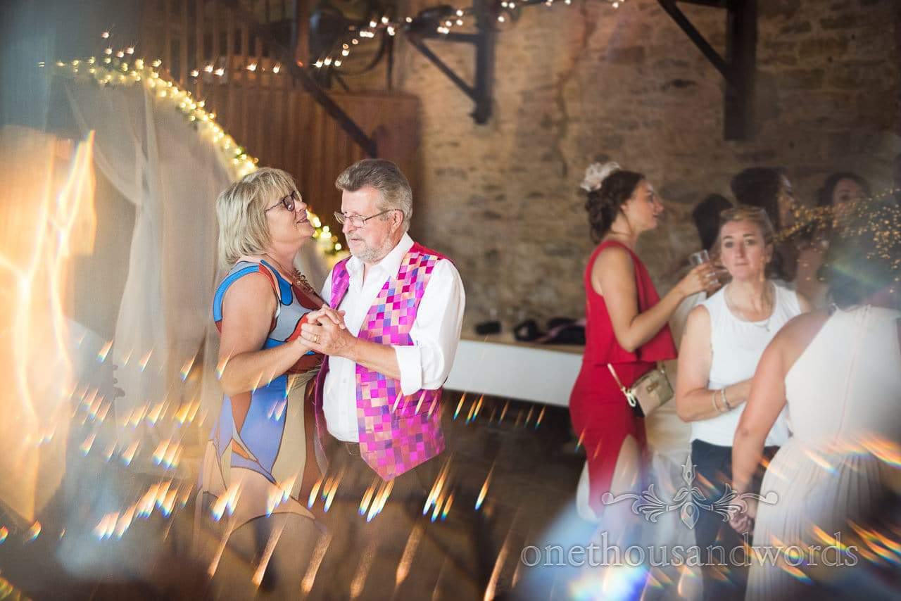 Dancing guests during barn reception at Purbeck Courtyard Wedding