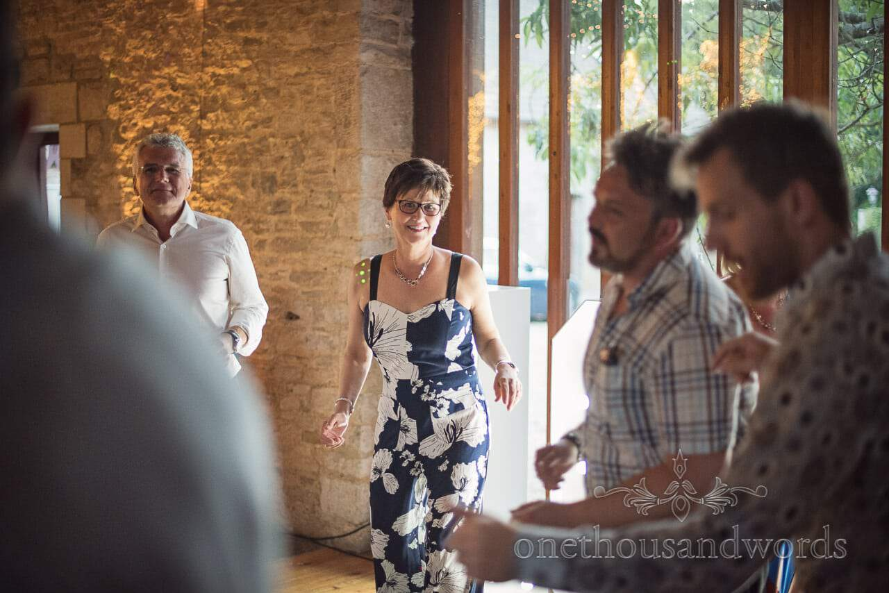 Dancing guests during evening reception at Purbeck Courtyard Wedding