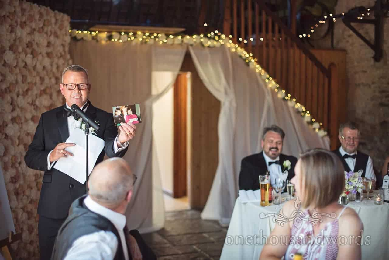 Father of the bride delivers speech at Country Courtyard Wedding