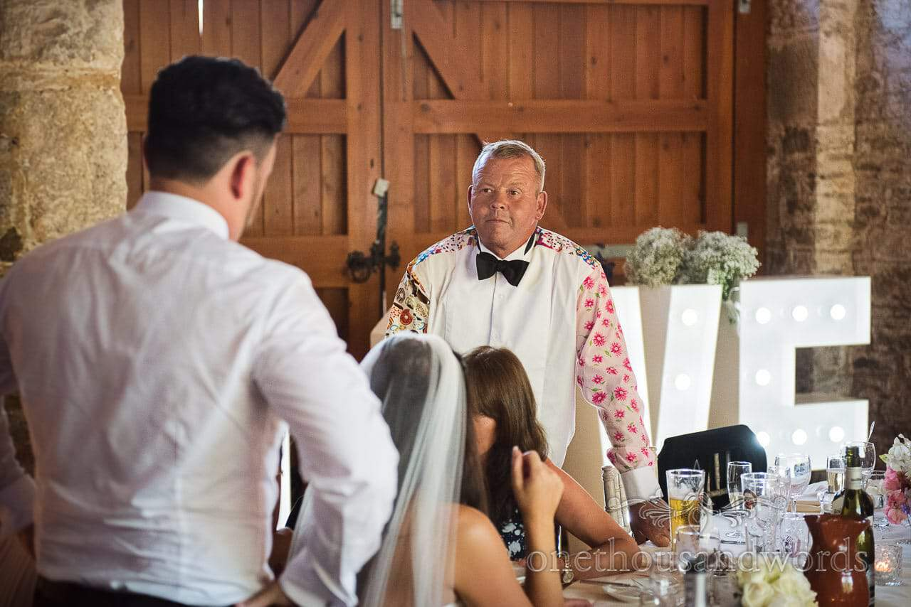 Father of the bride in loud shirt from Purbeck Courtyard Wedding