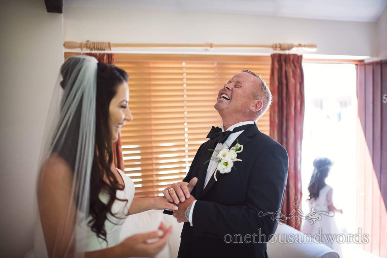 Father of the bride laughing from Purbeck Courtyard Wedding