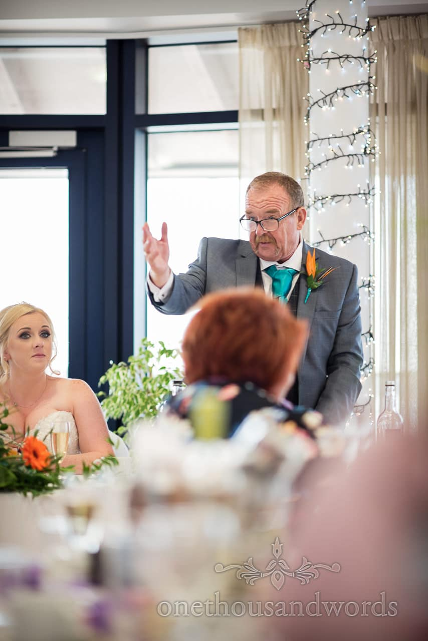 Father of the bride makes speech during wedding breakfast at RNLI College