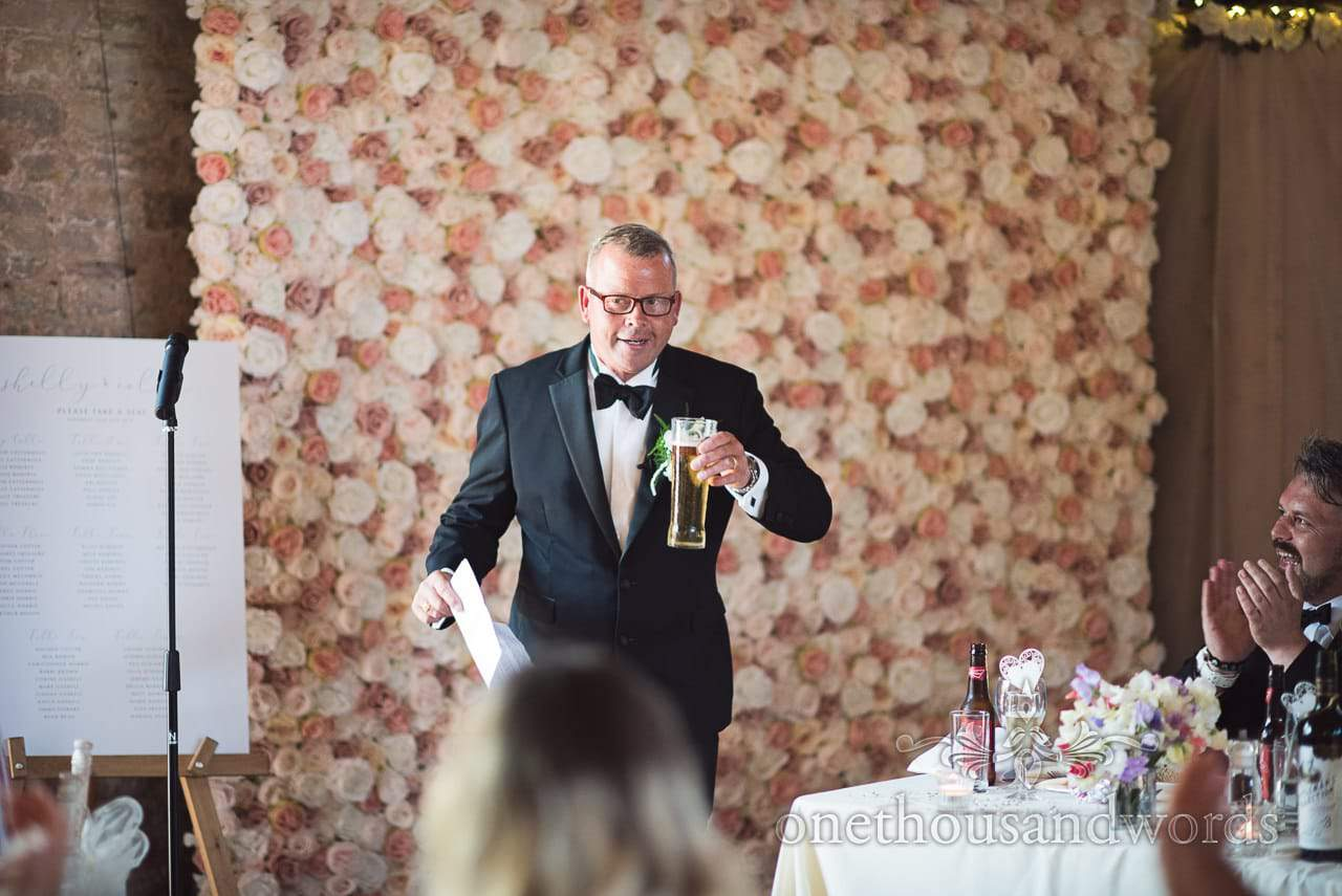 Father of the bride takes a drink during speech at Country Courtyard Wedding