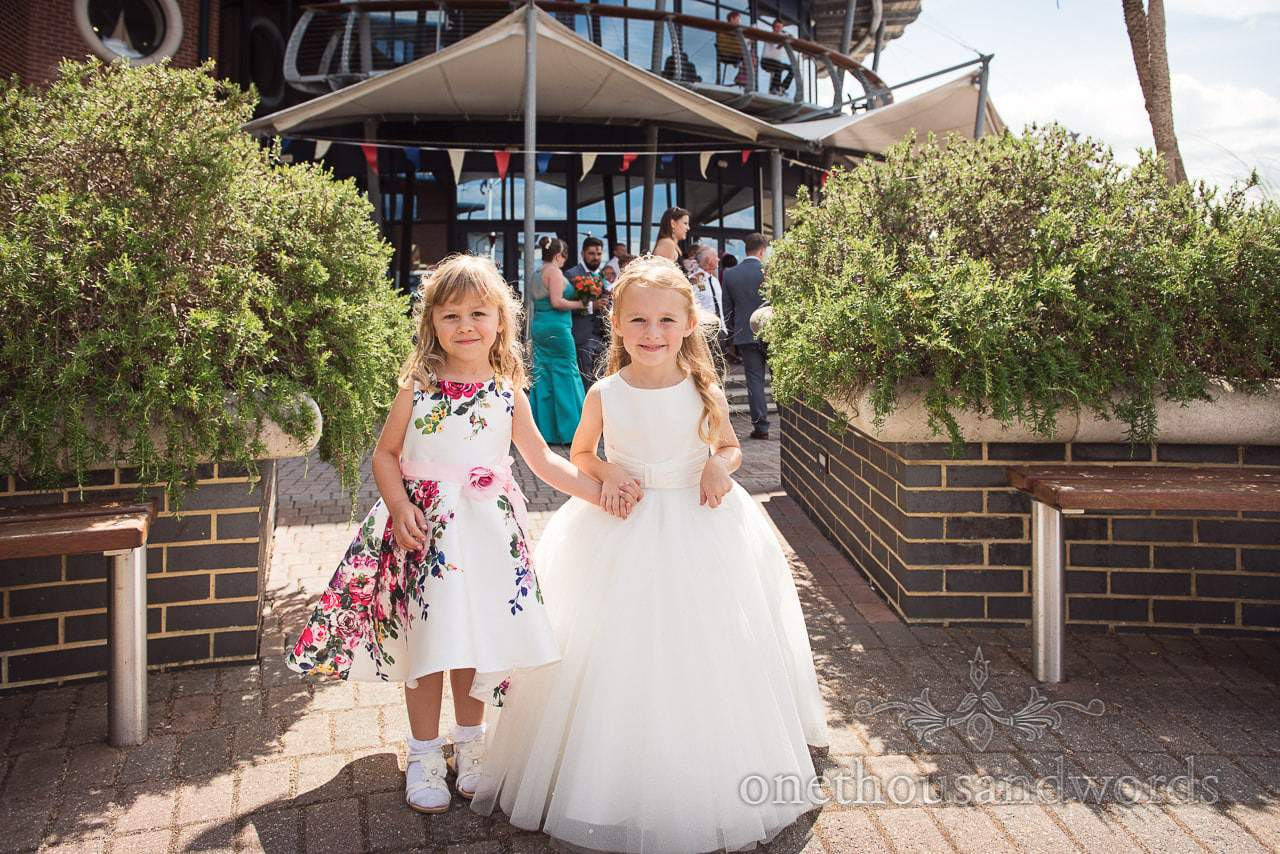 Flower girls at drinks reception at RNLI College Wedding venue in Poole