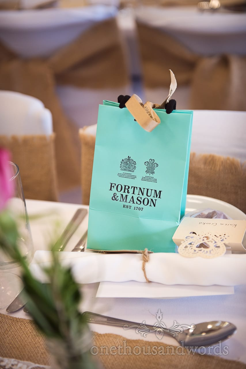 Fortnum and Mason gift bag on wedding breakfast table as wedding favour/ gift
