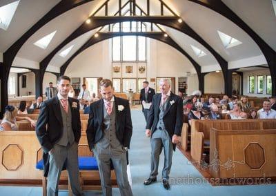 Groom and groomsmen await bride at Sandbanks Church Wedding in Poole