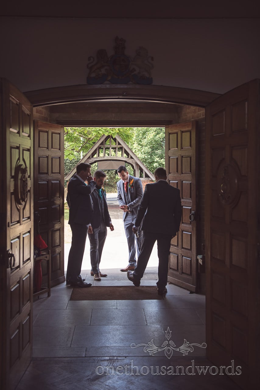 Groom and groomsmen wait for wedding guests outside Poole church wedding