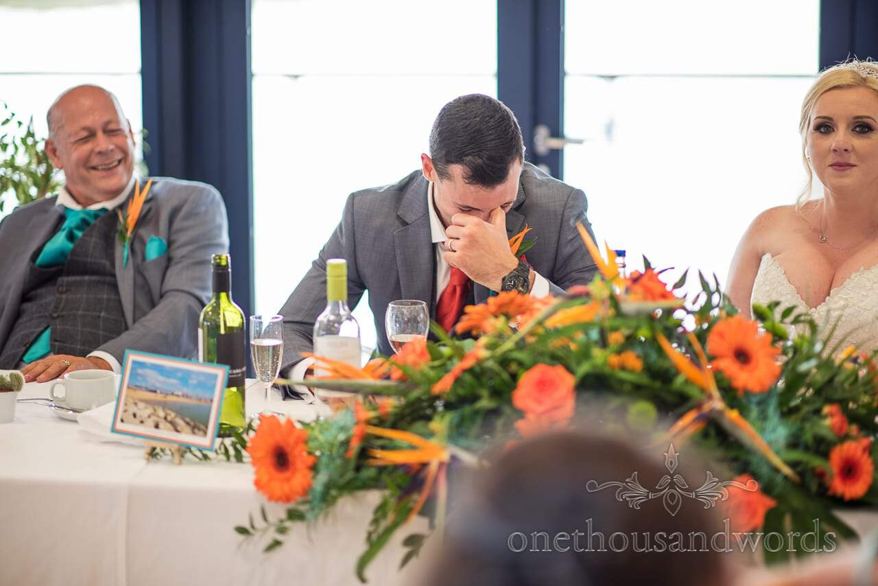 Groom hides his face during best man's speech at RNLI College Wedding