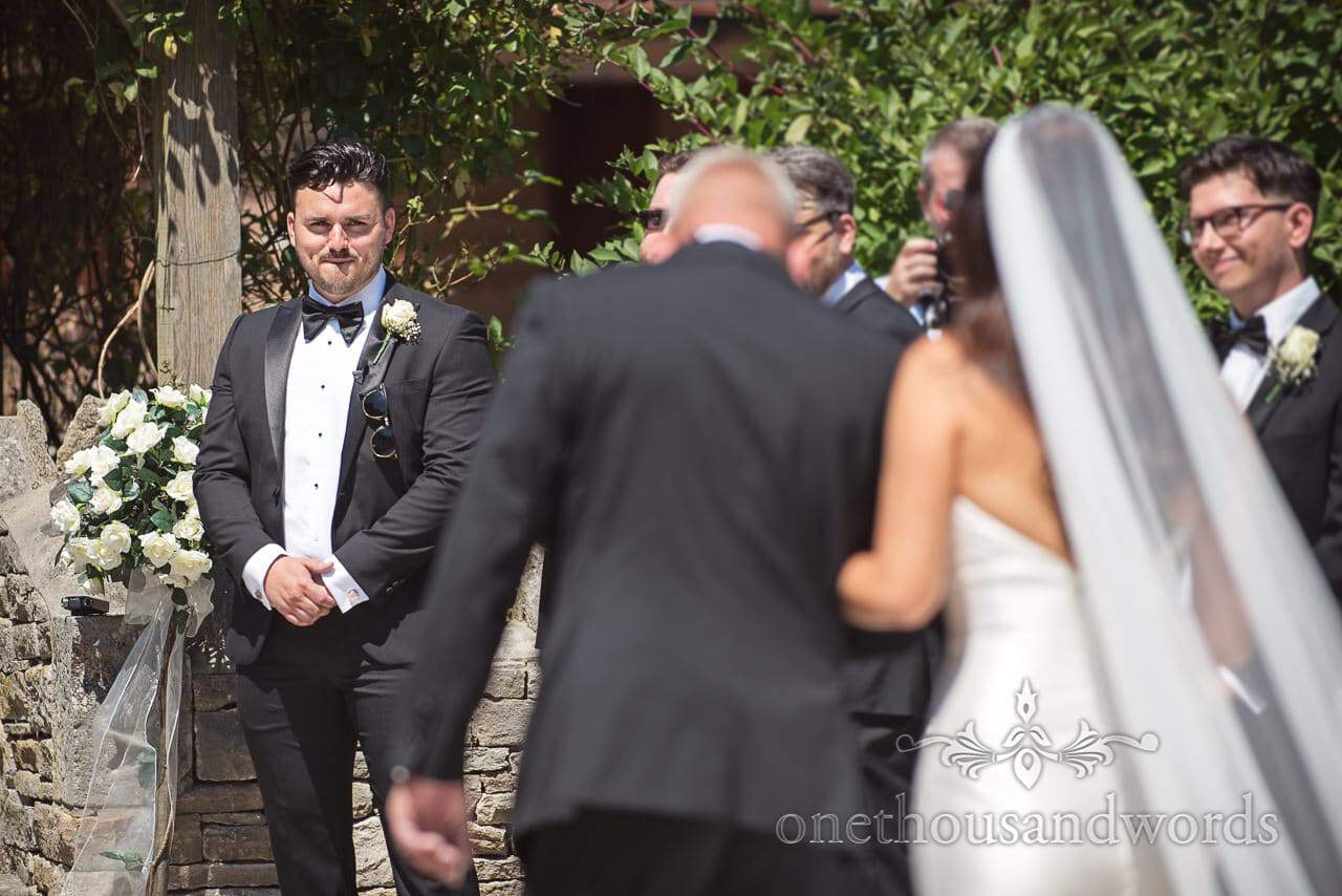 Groom lays eyes on his bride to be at Country Courtyard Wedding
