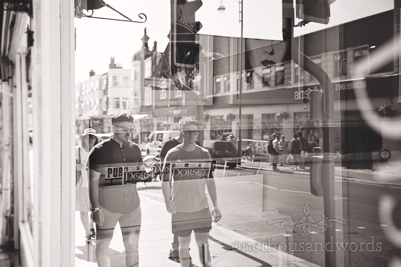 Groom reflection in Swanage cafe window from Courtyard Wedding