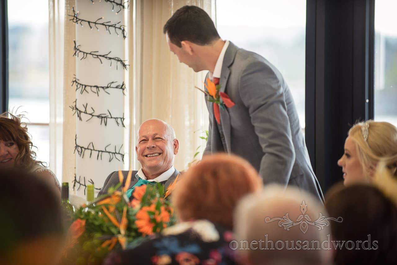 Groom's father laughs at wedding speeches at RNLI College Wedding