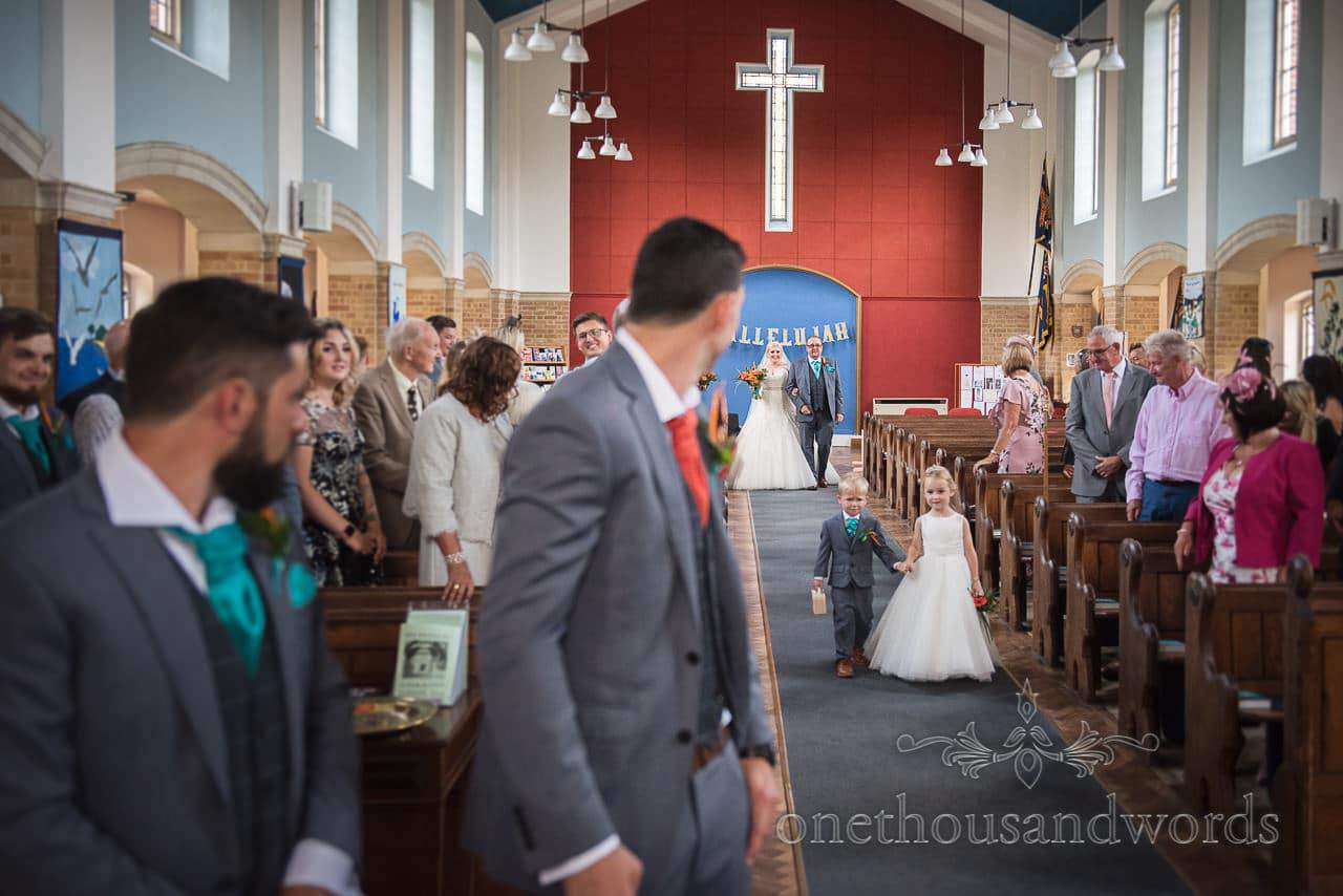 Groom sees bride for first time at church wedding ceremony in Poole, Dorset
