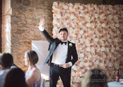 Groom strikes a pose while delivering speech at Country Courtyard Wedding