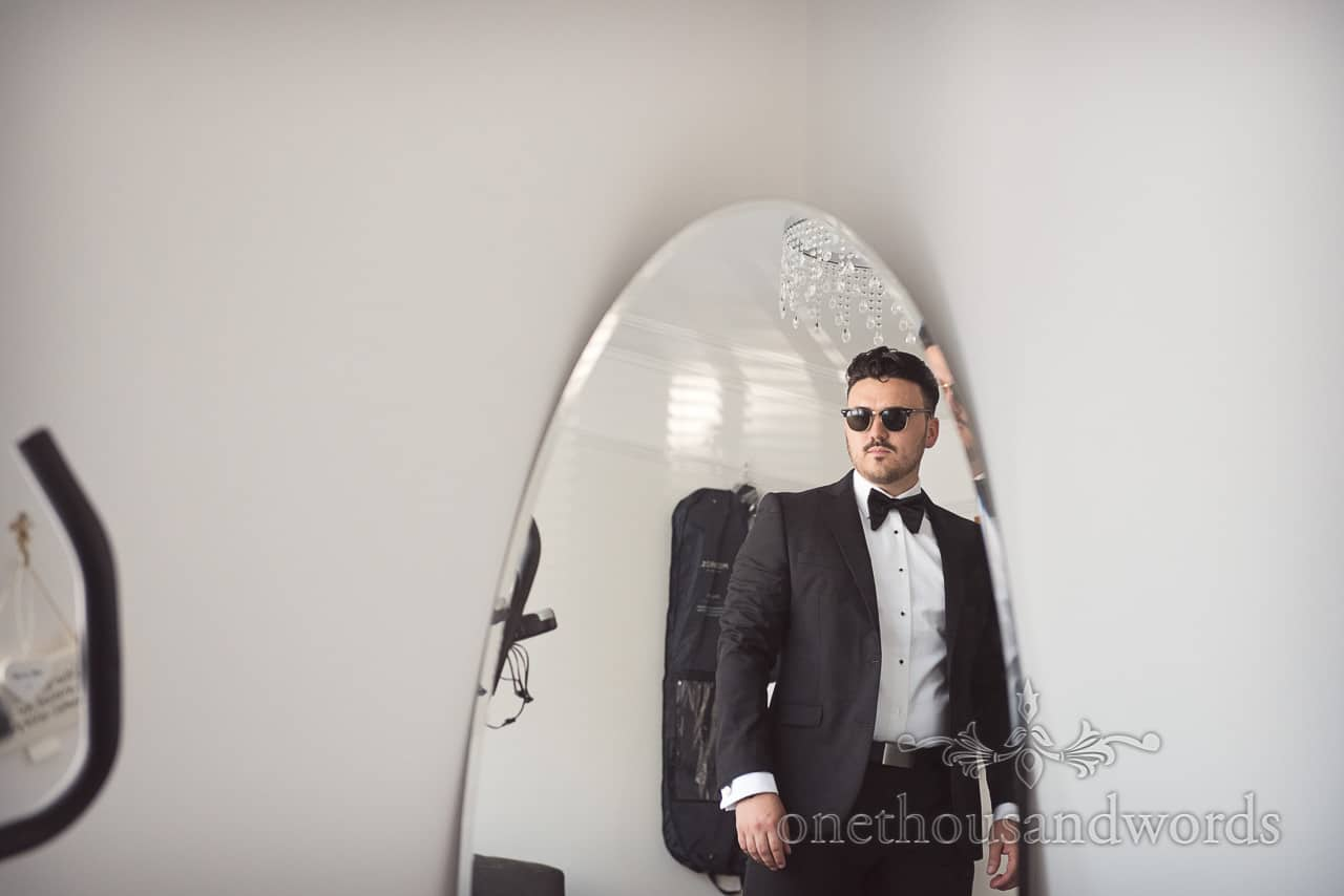 Grooms reflection in mirror wearing sunglasses from Country Courtyard Wedding