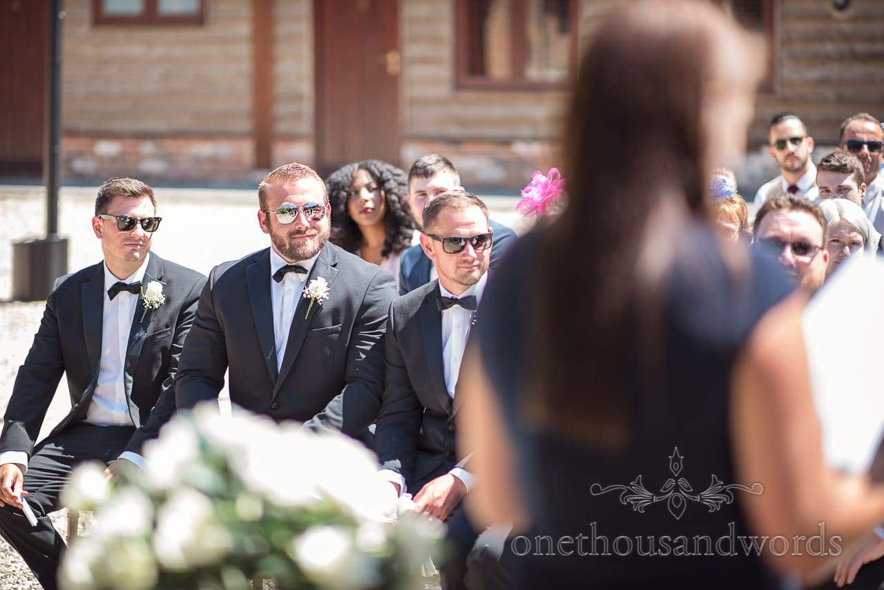 Groomsmen during outdoor ceremony at Country Courtyard Wedding