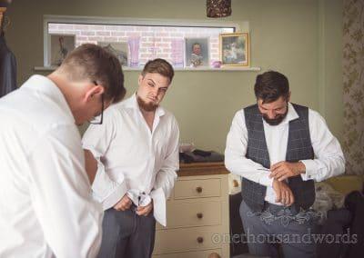 Groomsmen getting ready on morning for RNLI College Wedding Photographs