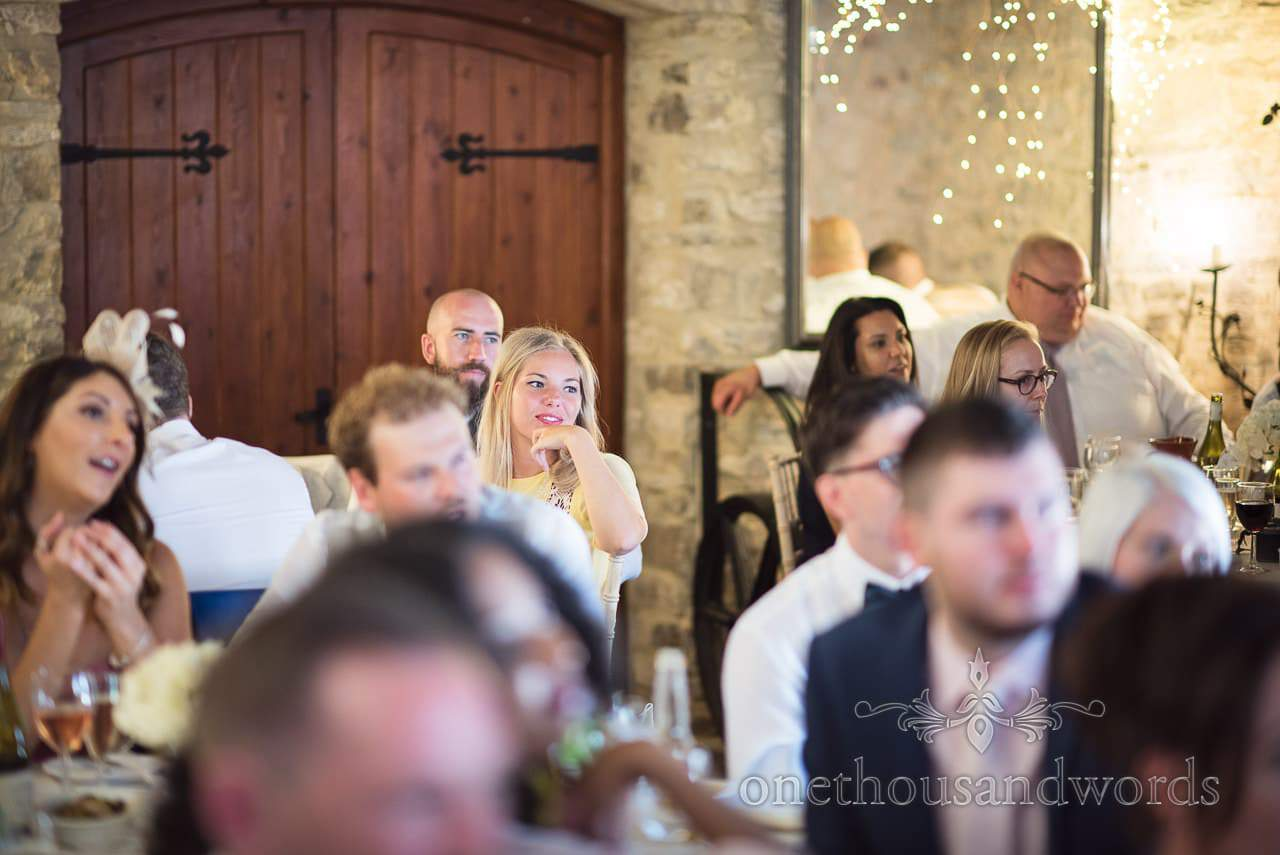 Guests during top table speeches at Purbeck Courtyard Wedding