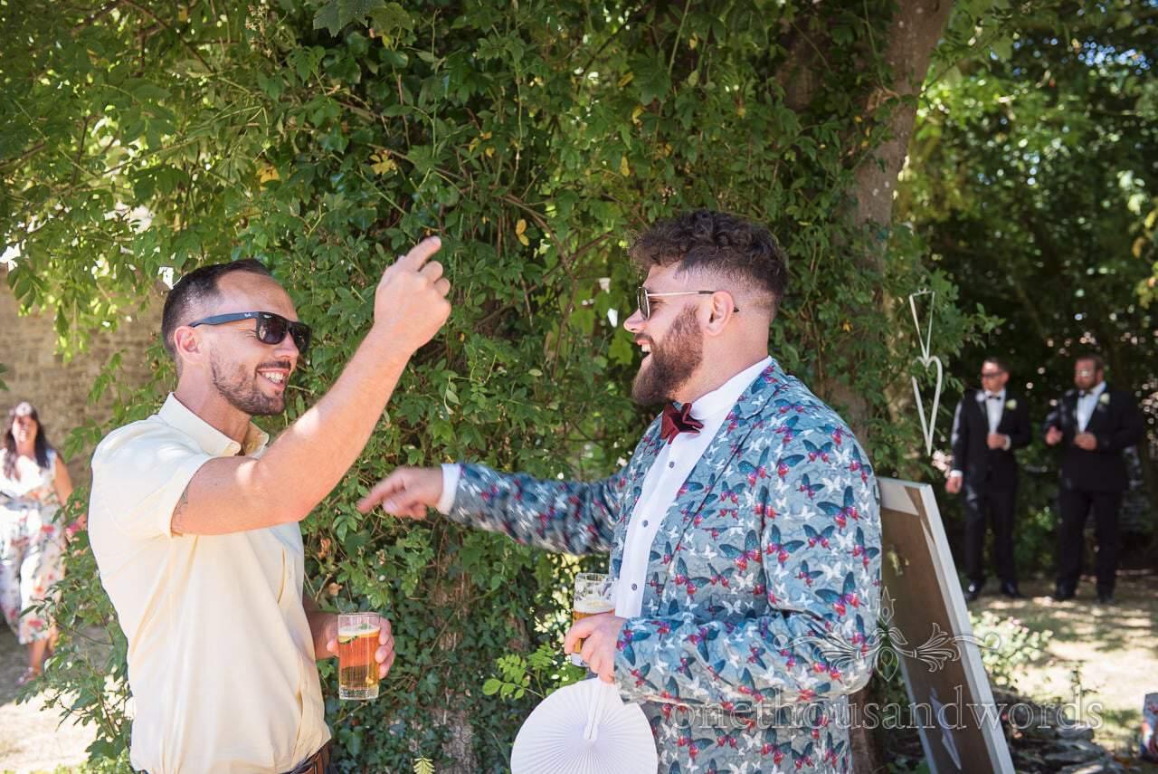 Guests enjoy a drink at garden reception at Courtyard Wedding