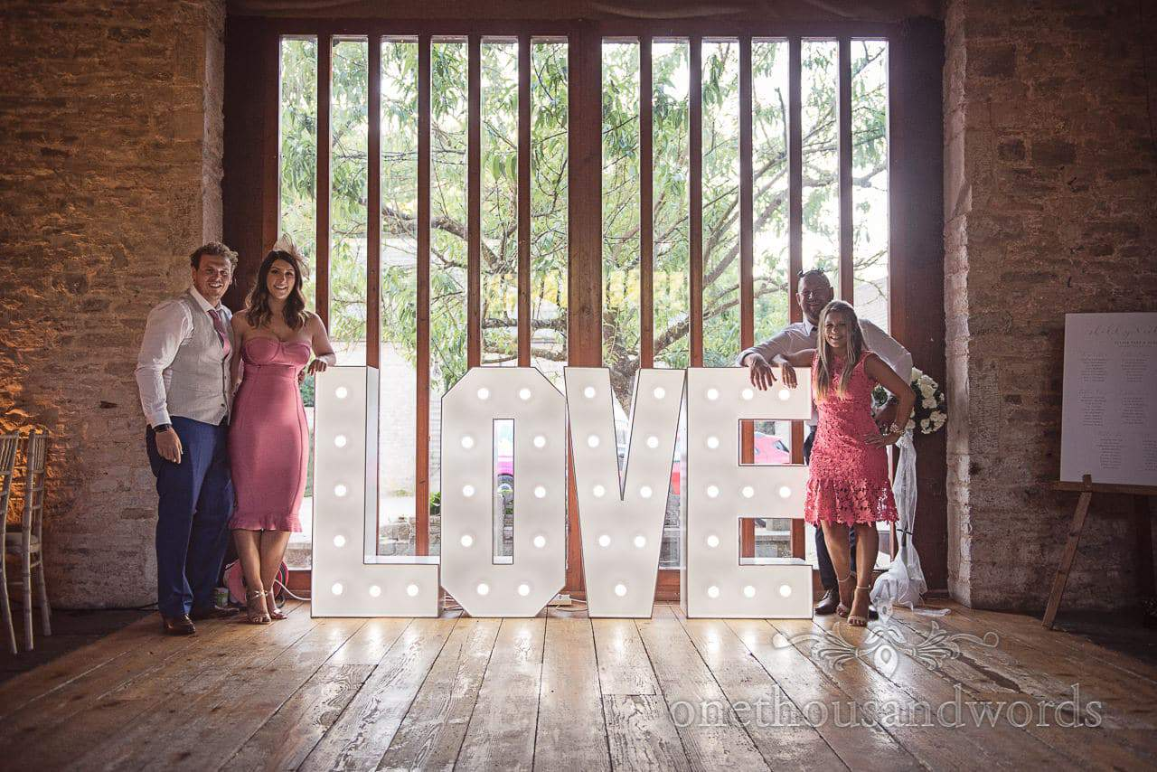 Guests pose with love letters at Purbeck Courtyard Wedding