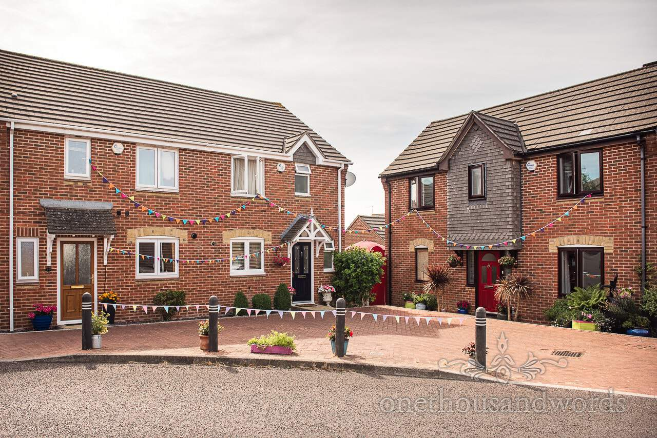 Houses decorated with bunting from morning of RNLI College Wedding Photographs