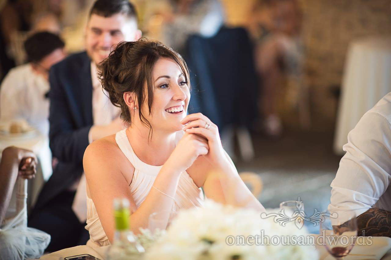 Laughing bridesmaid during speeches at Courtyard Wedding