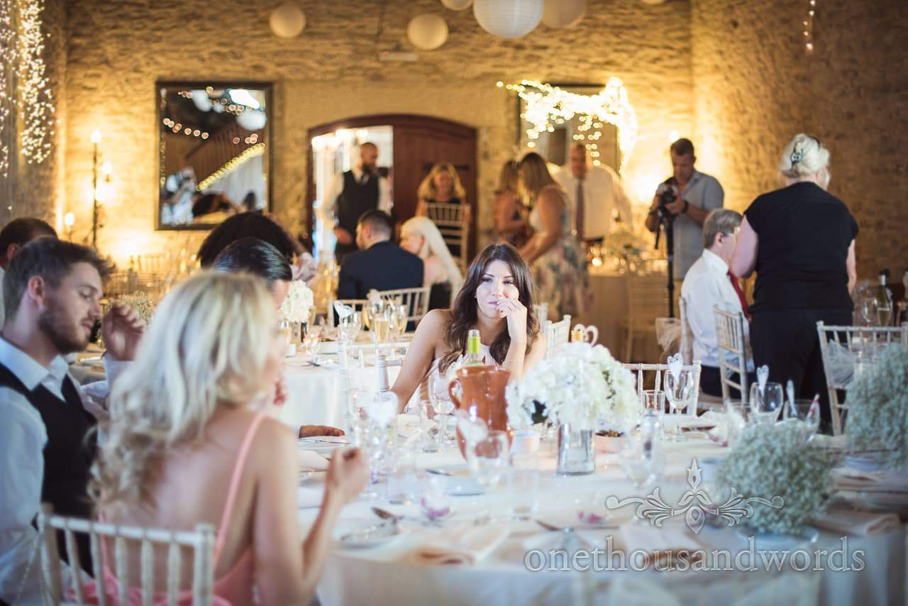 Maid of honor during wedding breakfast at Country Courtyard Wedding
