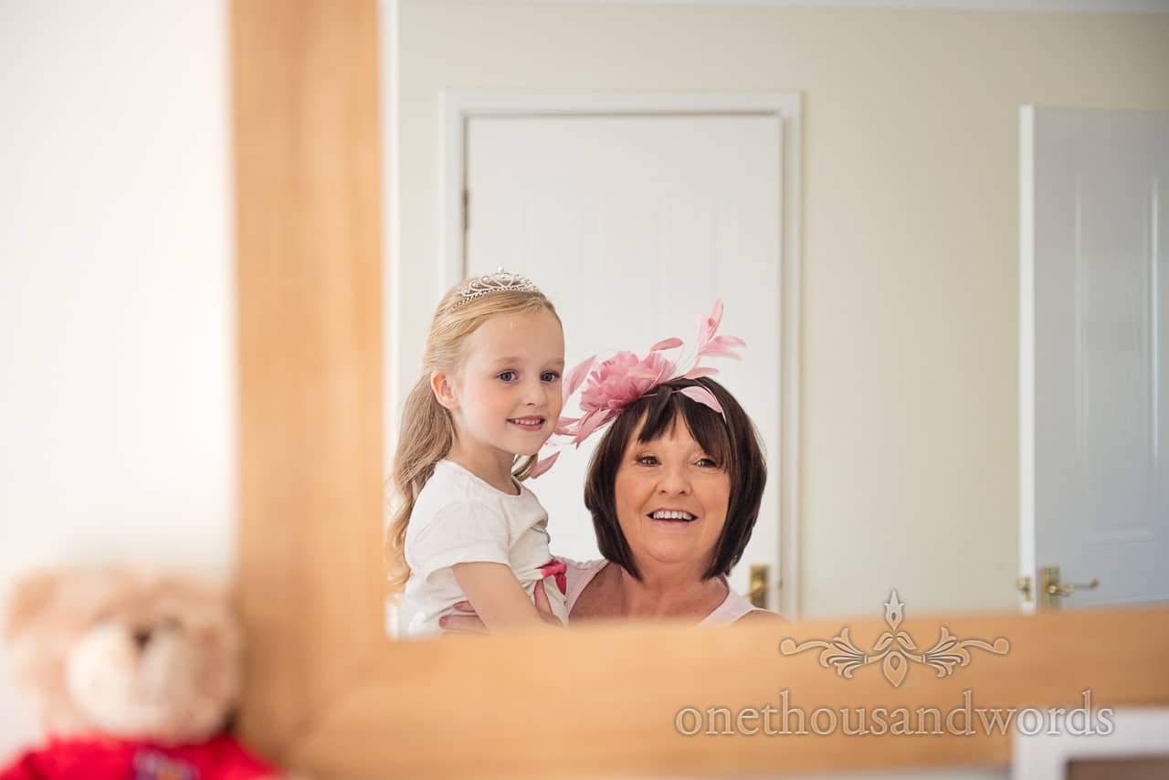 Mother of the bride and flower girl in mirror before RNLI College Wedding Photographs