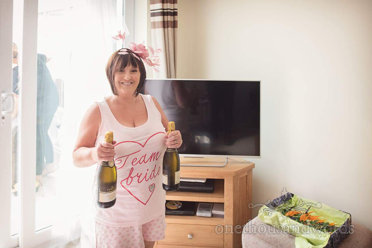 Mother of the bride armed with bubbles at RNLI College Wedding Photographs