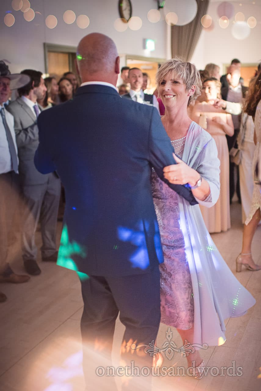 Mother of the bride dances at Harmans Cross Village Hall Wedding evening