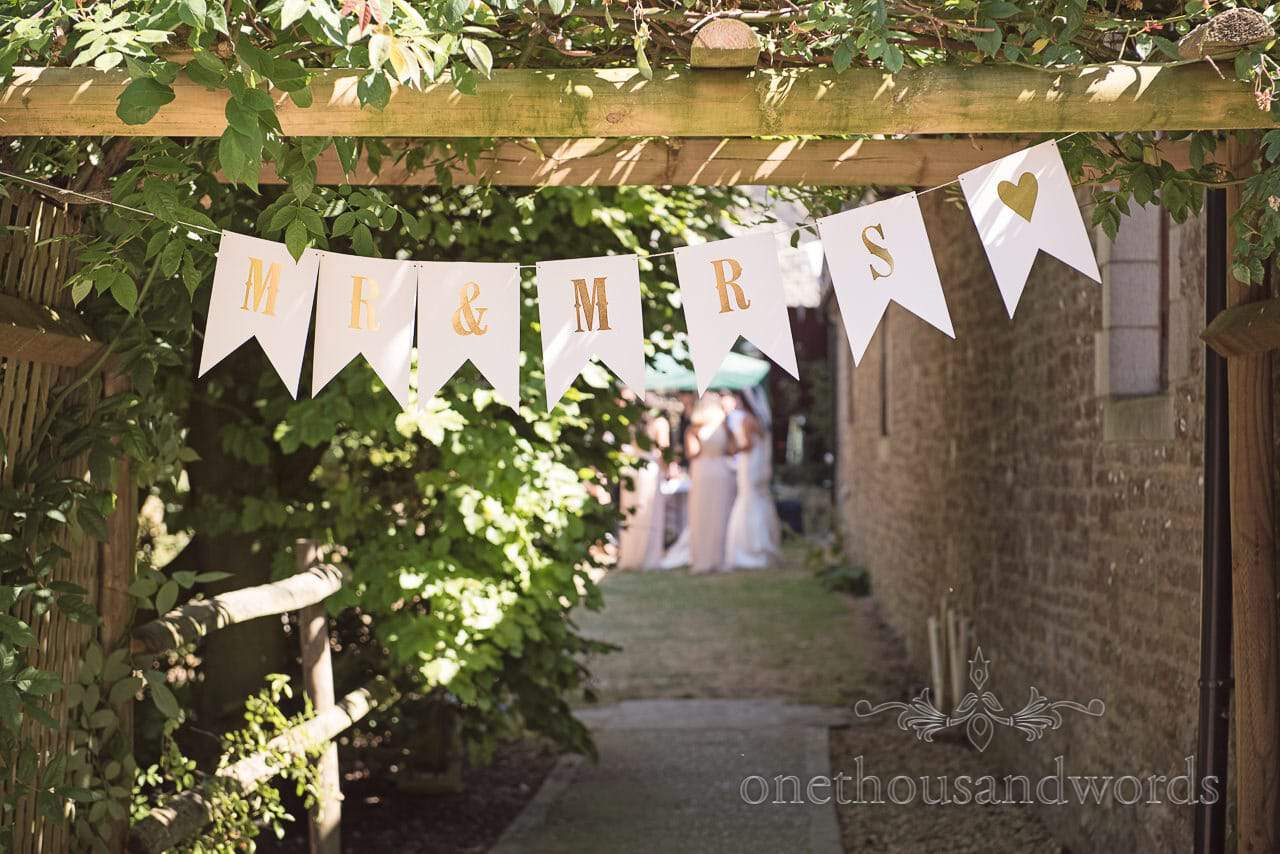 Mr and Mrs bunting in garden at Country Courtyard Wedding