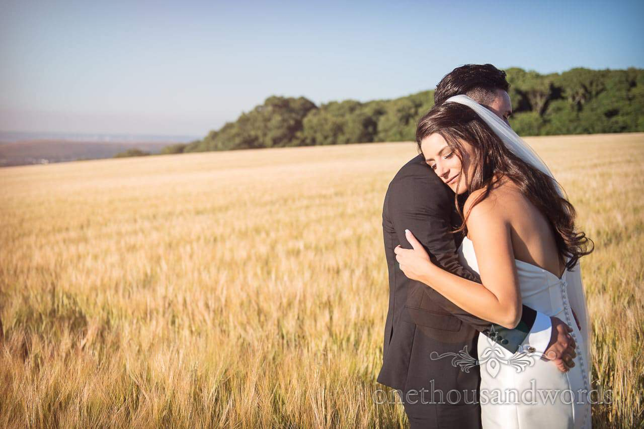 New Mr and Mrs embrace during Country Courtyard Wedding