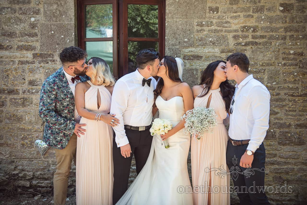Newlyweds and guests kissing at Country Courtyard Wedding