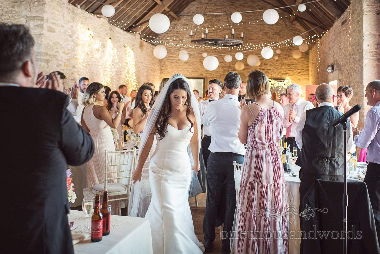 Newlyweds are welcomed at the wedding breakfast
