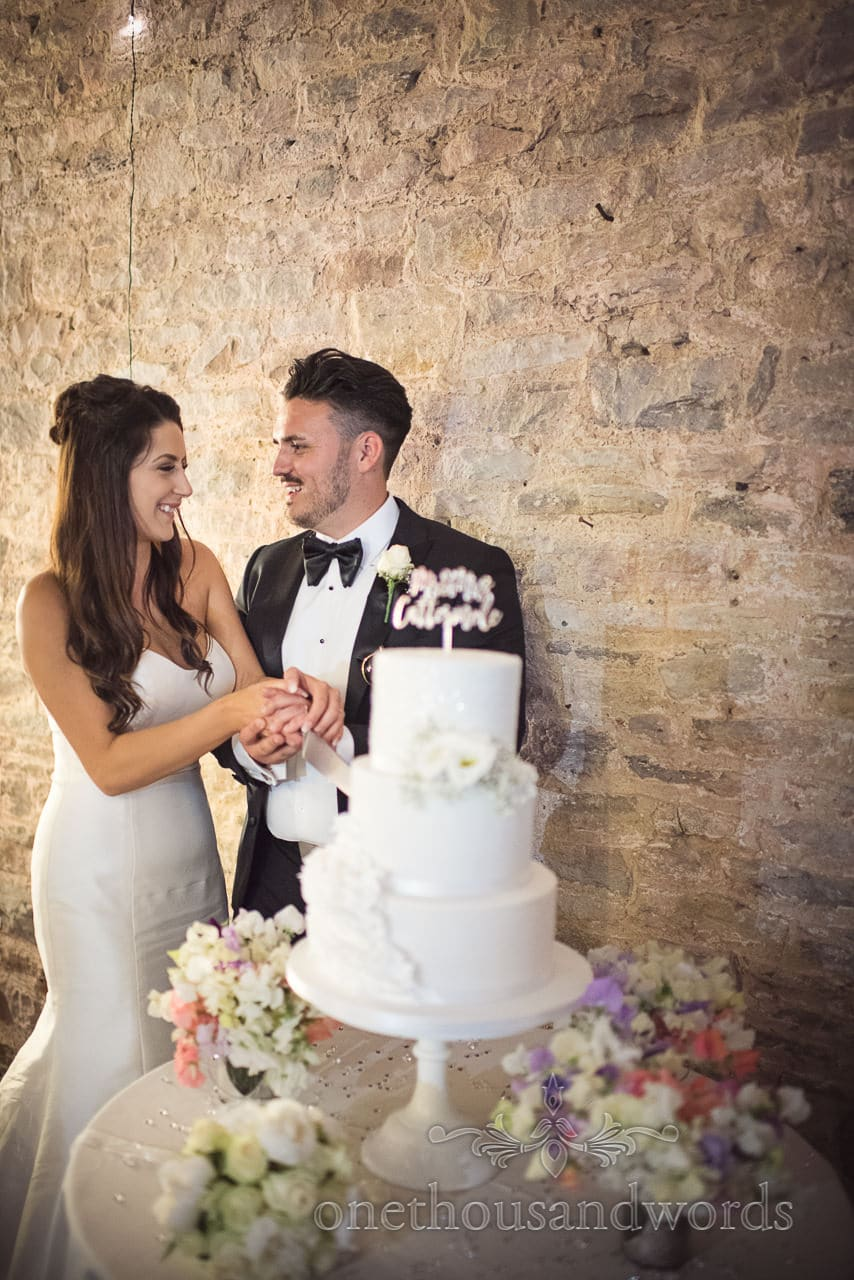 Newlyweds cut the cake at country Courtyard Wedding